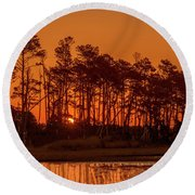Sunrise Along A Tree Line Round Beach Towel