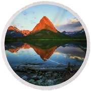 Sunrise At Many Glaciers Round Beach Towel by Craig J Satterlee