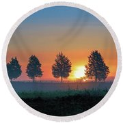 Round Beach Towel featuring the photograph Sunrise Behind The Cedars by Lori Coleman