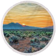 Sunrise Over Taos Round Beach Towel