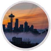 Sunrise Seattle Skyline Above The Fog Round Beach Towel