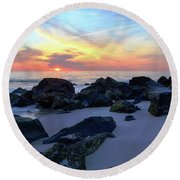 Sunrise Through The Rocks Round Beach Towel
