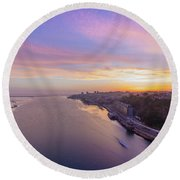 Sunset And A Small Boat Round Beach Towel