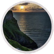 Sunset At Rhossili Bay Round Beach Towel