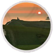 Sunset At The Belle Tout Lighthouse Round Beach Towel