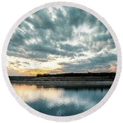 Sunset Behind Small Hill With Storm Clouds In The Sky Round Beach Towel