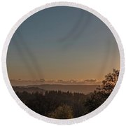 Sunset Behind Tree With Forest And Mountains In The Background Round Beach Towel