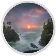 Round Beach Towel featuring the photograph Sunset Between Sea Stacks With Trees Of Oregon Coast by William Lee