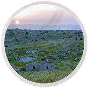 Sunset Over A 2000 Years Old Village Round Beach Towel