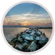 Sunset Over A Rock Jetty On The Chesapeake Bay Round Beach Towel