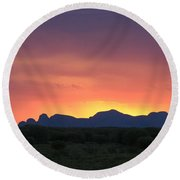 Round Beach Towel featuring the photograph Sunset Silhouette Of Kata Tjuta In The Northern Territory by Keiran Lusk
