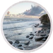 Sunset View In The Distance With Large Rocks On The Beach Round Beach Towel