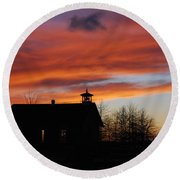 Sunsetting Behind The Historic Schoolhouse. Round Beach Towel