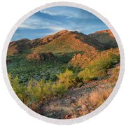 Superstitions At Dusk Round Beach Towel by Greg Nyquist