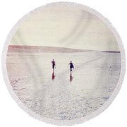 Round Beach Towel featuring the photograph Surfers In The Snow by Lyn Randle