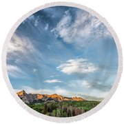 Sweeping Clouds Round Beach Towel by Jon Glaser