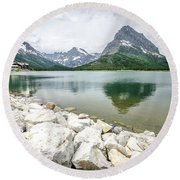 Round Beach Towel featuring the photograph Swiftcurrent Lake by Margaret Pitcher