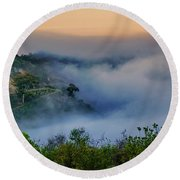 Switchbacks In The Clouds Round Beach Towel by Joseph Hollingsworth