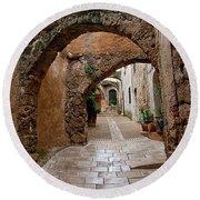The Archways Of Villecroz Round Beach Towel