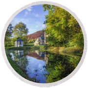 Round Beach Towel featuring the photograph The Autumn Pond by Ian Mitchell