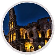 The Coleseum In Rome At Night Round Beach Towel