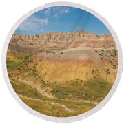 The Colors Of Badlands National Park Round Beach Towel by Brenda Jacobs
