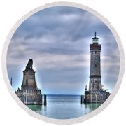 the entrance of the harbour of Lindau at the Lake Constance Round Beach Towel