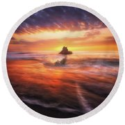 The Flaming Rock Round Beach Towel