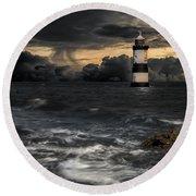 The Lighthouse Storm Round Beach Towel