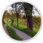 The Long Road In Autumn Round Beach Towel