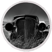 The Old Buick Round Beach Towel by Marius Sipa