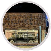 The Old Packard Dealership Round Beach Towel