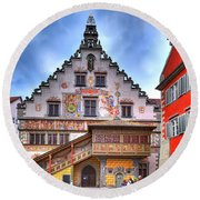 the old townhall on the island of Lindau at the Lake Constance Round Beach Towel