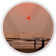 Round Beach Towel featuring the photograph The Orange Moon by Sher Nasser