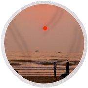 The Orange Moon Round Beach Towel