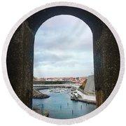 The Port Of Angra Do Heroismo From A Window In Forte De Sao Sebastiao Round Beach Towel