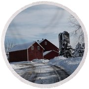 The Red Barn In The Snow Round Beach Towel