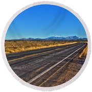 The Road To Flagstaff Round Beach Towel