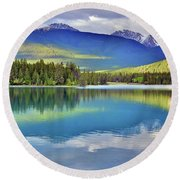 Round Beach Towel featuring the photograph The Rockies Reflected In Lake Annette by Tara Turner