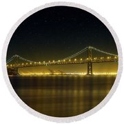 The San Francisco Oakland Bay Bridge At Night Round Beach Towel