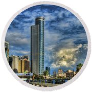 The Skyscraper And Low Clouds Dance Round Beach Towel