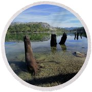 Round Beach Towel featuring the photograph The Stir Of Echoes by Sean Sarsfield
