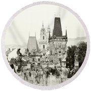 Round Beach Towel featuring the photograph The Stream Of People On Charles Bridge. Prague by Jenny Rainbow