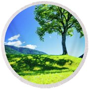 Round Beach Towel featuring the photograph The Tree On The Hill by Silvia Ganora