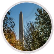 Round Beach Towel featuring the photograph The Washington Monument In Fall by Ed Clark