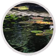 Round Beach Towel featuring the photograph The Water Lily by Cendrine Marrouat