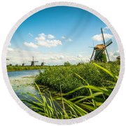 Round Beach Towel featuring the photograph The Wind Mills Of Kinderdjik by Hannes Cmarits