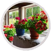Three Pots Of Geraniums On Windowsill Round Beach Towel