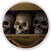 Three Skulls In Suitcase Round Beach Towel