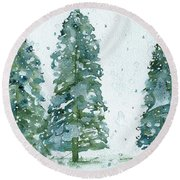 Round Beach Towel featuring the painting Three Snowy Spruce Trees by Dawn Derman